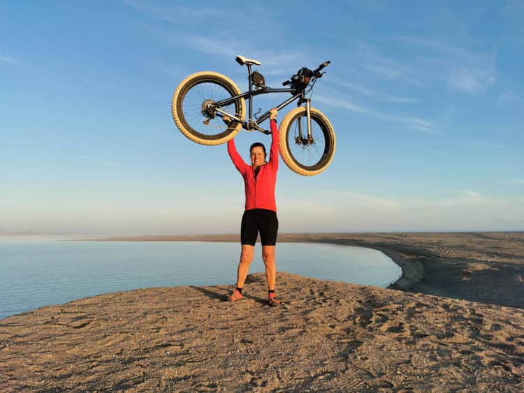 Kate Leeming and her bike after cycling Namibia's Skeleton Coast