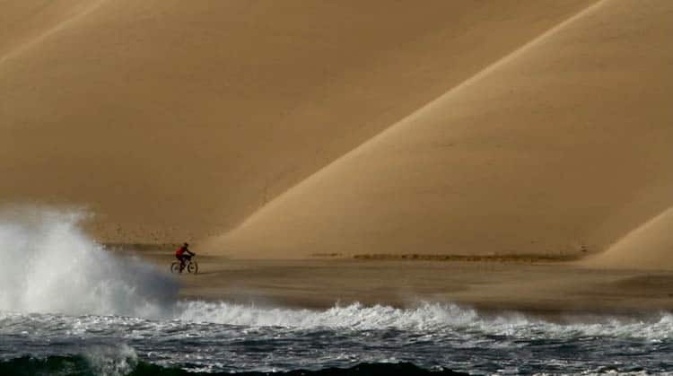 Racing the tide beside the Lange Wand of Namibia's Skeleton Coast.