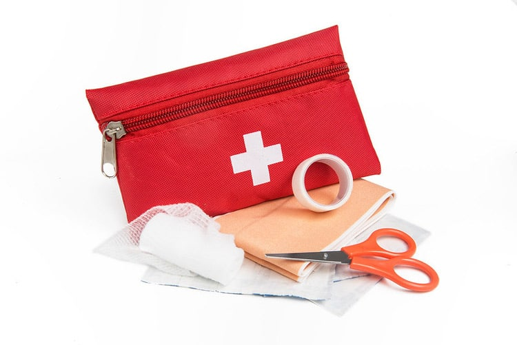 First aid kits help you stay well during travel. CC Image by www.directline.com