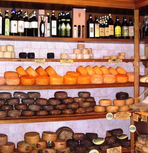 Wine and cheese shops beckon throughout Tuscany. Photo by Victor Block
