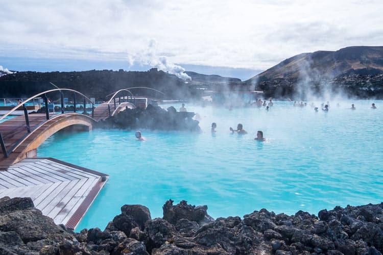 People enjoying the Blue Lagoon steamy waters
