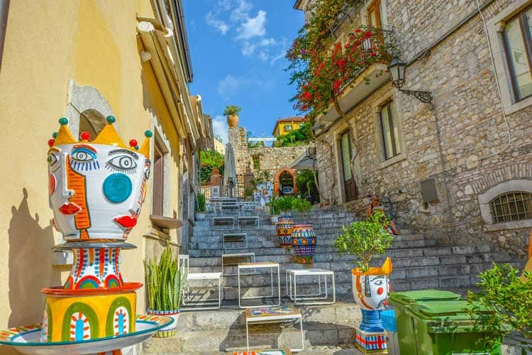 Art-lined stairways throughout Sicily