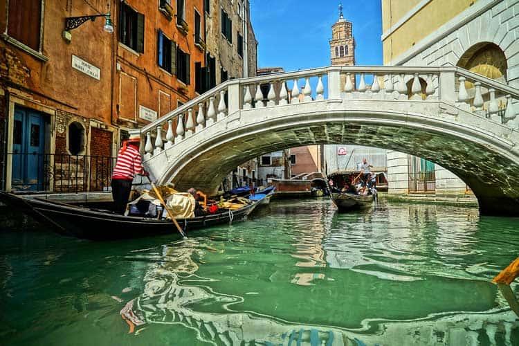 Enjoying a gondola ride through Venice