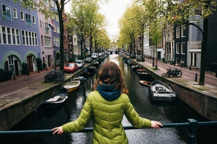 Canals in Amsterdam reached by Interrail train in Europe