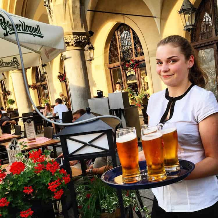 Drinking beer in Market Square is one of the top things to do in Krakow