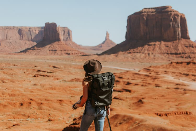 Woman Hiking in the Desert by Ivana Cajina