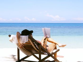Woman Reading on the Beach by Chen Mizrach