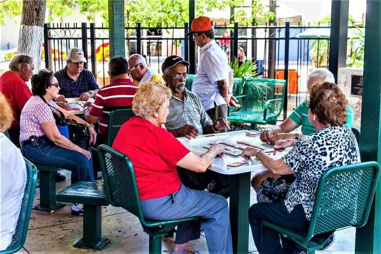 Dominoes are as popular in Miami's ethnic enclave, Little Havana as in Cuba. Photo by Victor Block