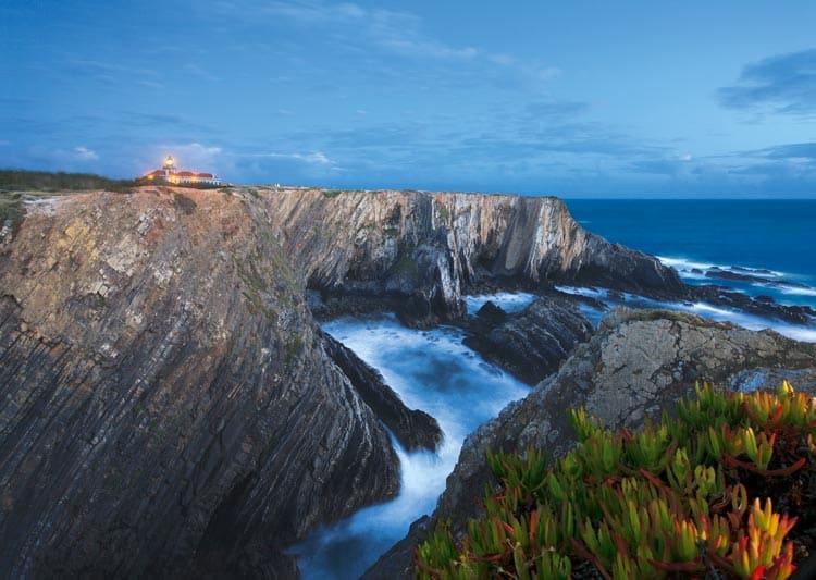 Lighthouse at dawn on coast