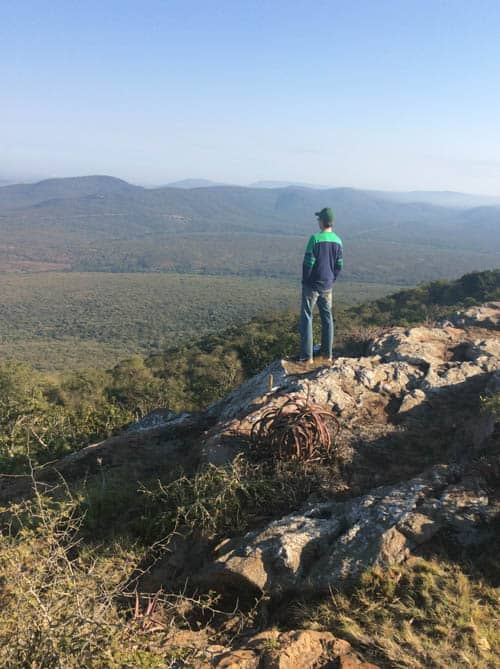Community Tourism. The author takes in the scenery from Shewula Mountain Camp