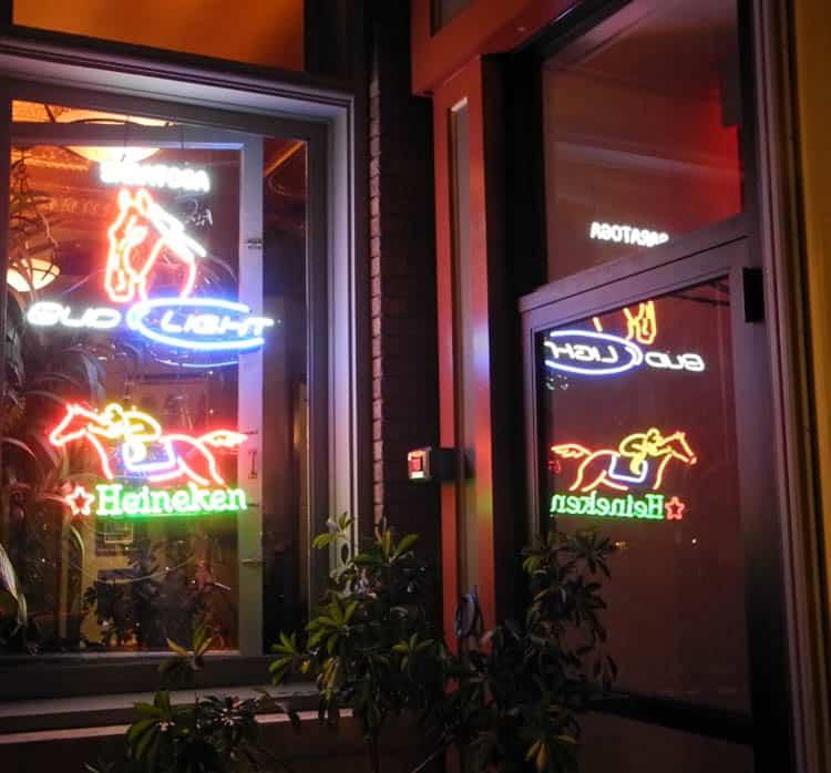 Restaurant windows lit with horse and jockey lights