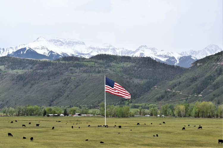 Yellowstone Road Trip Flag and mountain north of Ouray, CO