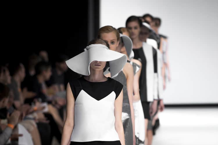 Models on a catwalk during a Fashion Week sailing. Photo by Martinkay78/Dreamstime