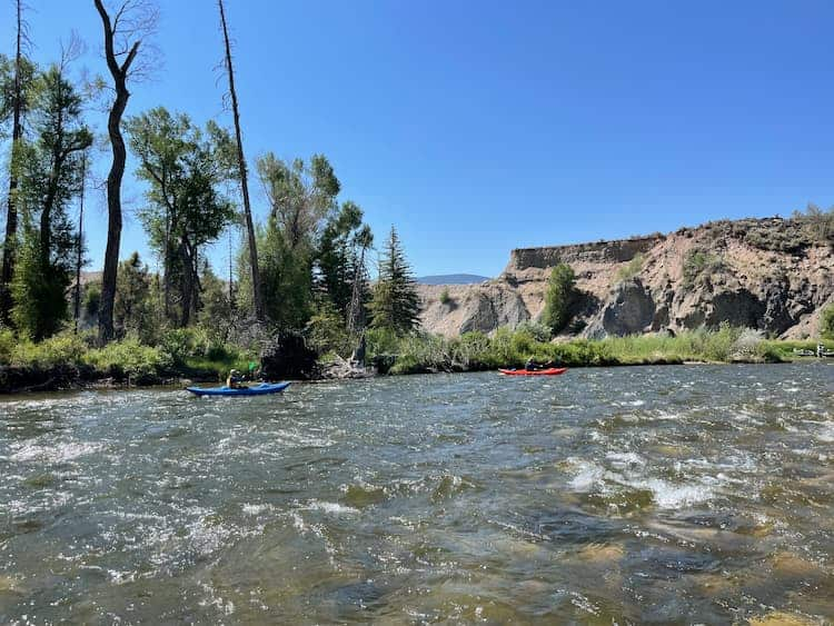 Kayaking on a River Near Vail, Colorado by Janna Graber