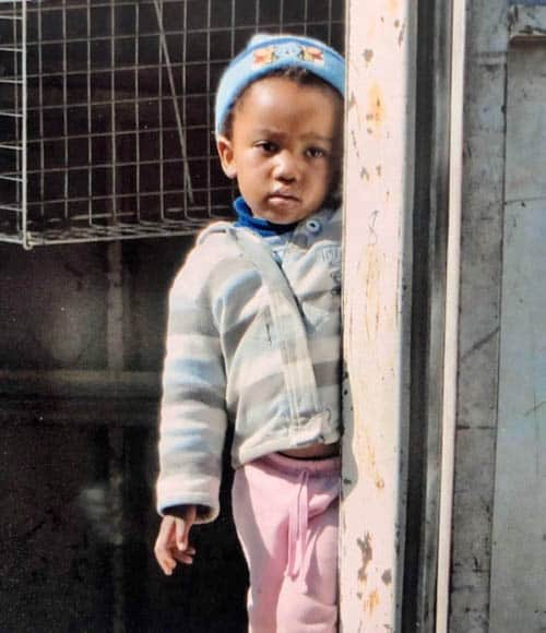 African adventure Driving through Maseru and a child watches us from her front door