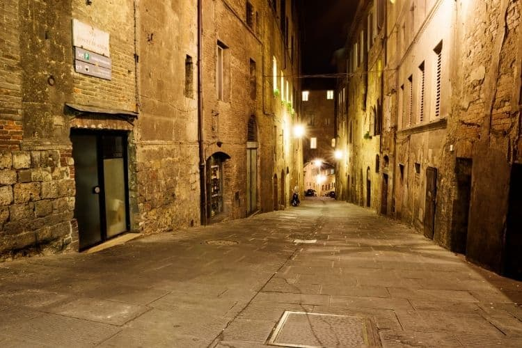 Studying abroad in Italy Siena streets at night canva
